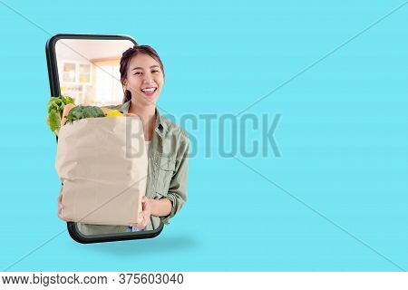 Young Attractive Asian Female Hold Shopping Groceries Bag Happy Smiling On Supermarket Online Store