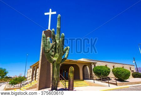 Exterior Of Desert Church With Cross & Large Saguaro Cactus
