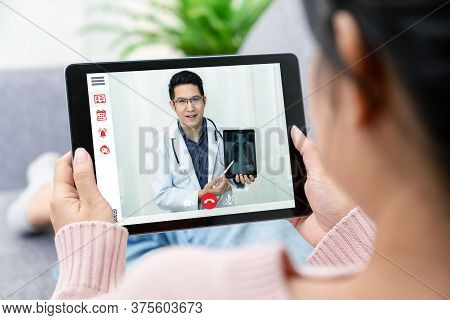 Asian Chinese Doctor Video Conference Call Online Live Talk Follow Up Remotely In Medical Coronaviru