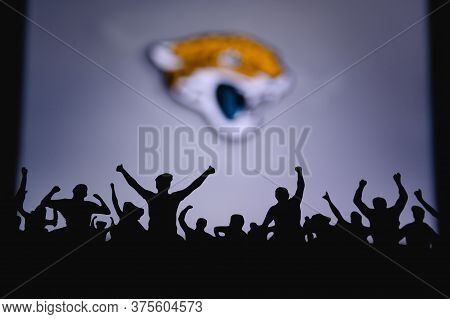 Jacksonville Jaguars. Fans Support Professional Team Of American National Foorball League. Silhouett