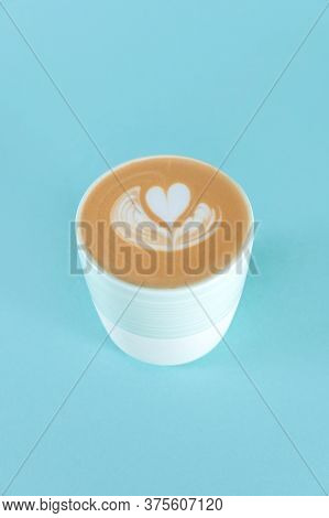 Blue Cup Of Latte Art With Copy Space. Hot Fresh Milk With Latte In Cup On Bluebackground