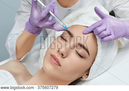 Beautiful Woman Getting Beauty Facial Injections Into Her Forehead. Beauty Treatment And Cosmetology