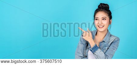 Banner Of Happy Asian Woman Standing Pointing Hands To Copyspace On Blue Background. Cute Asia Girl