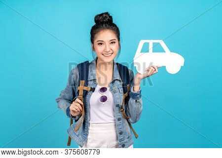 Portrait Of Young Happy Carefree Asian Woman Holding White Paper Car In Concept Of Back To Domestic