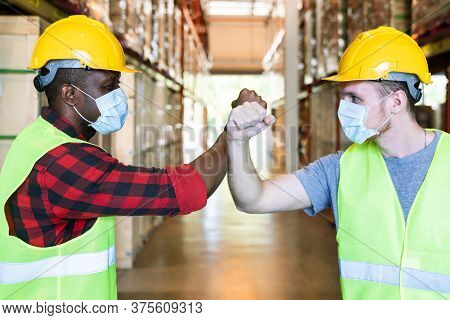 Elbow Greeting To Avoid The Spread Of Coronavirus (covid-19). African And Caucasian Worker Man Wear