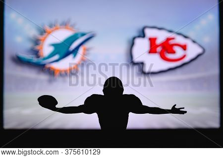 Miami Dolphins Vs. Kansas City Chiefs. Nfl Game. American Football League Match. Silhouette Of Profe