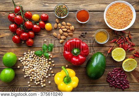 Selection Of Healthy Food On Wooden Background, Top View. Fresh Vegetables, Fruits, Cereals And Bean
