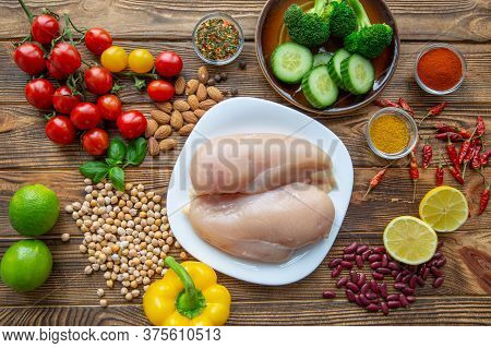 Selection Of Natural Fruits, Vegetables And Dietic Chicken Meat, Top View. Healthy Lifestyle.
