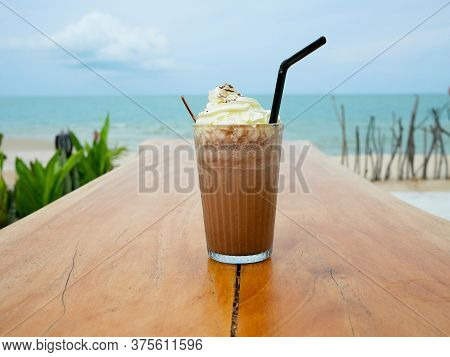 Chocolate Frappe Or Chocolate Ice Blended With Whipped Cream On Wooden Table