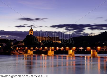 View Of The St. Fridolin Cathedral And Rhine Bridge In Bad Saeckingen At Sunset