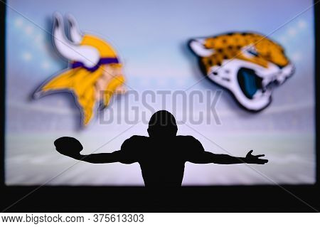 Minnesota Vikings Vs. Jacksonville Jaguars . Nfl Game. American Football League Match. Silhouette Of