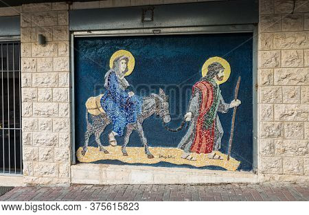 Jerusalem, Israel, December 28, 2018 : Exterior Wall Of A House With A Mosaic Of Johany Sofer Depict