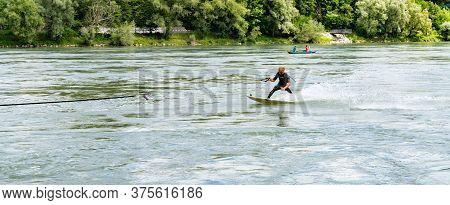 Professional Bungee Surfer Sebastian Dessecker Bungee Surfing On The Rhine Near Bad Saeckingen