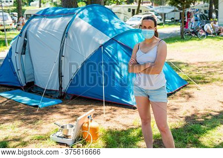 Woman Wearing Medical Mask Standing In Front Of A Camping Tent In Resort.