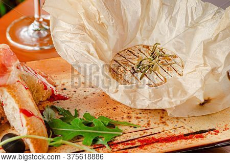 Grilled Camembert Cheese With Rosemary. French Cuisine, Restaurant Serving.