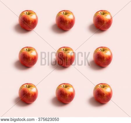 Fresh Raw Red Apples Pattern At Pink Background. Concept Of Minimal Harvest Background