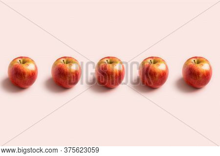 Apples In A Row At Pink Background. Minimal Pattern With Copy Space For Text Or Logo. Harvest Food