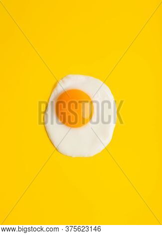 Close Up Fried Egg At Yellow Background With Free Space. Minimal Concept Of Breakfast For One Person