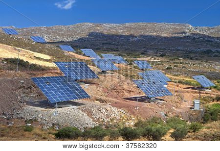 Solar panels mounted on a hillside