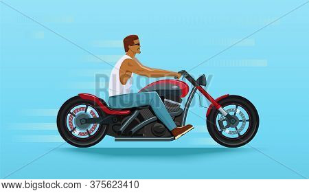 Manly Handsome Biker Rides A Cruiser Motorcycle In Red And Black Colors. Side View Of A Stylish Chop