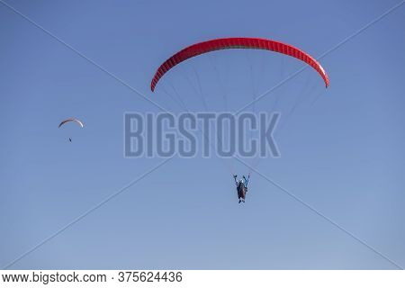 Paraglider In The Popular Area For Parachuting On The Side Of Korylovos In Drama