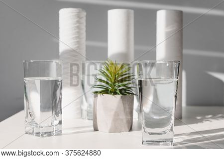 Concept Household Filtration System. Water Treatment Concept. Use Of Water Filters At Home. Glasses