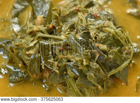Boiled Cassia Tree Leaf Or Thai Copper Pod With Coconut Milk And Curry On Bowl