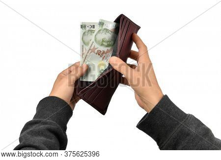 Turkish man with 40 Liras in his wallet isolated on white background