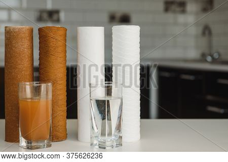 Water Filter Cartridge Used And A Glass Of Dirty Water And New Pure Filter With A Glass Of Clean Wat