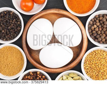 Raw Chicken Eggs, Black Pepper, Masala Powder, Fenugreek, Green Cardamom, Hot Red Chili Pepper, Clov