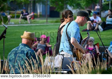 Anoka, Mn/usa - July 8, 2020. A Group Of Musicians Perform At An Outdoor Concert At A City Park.