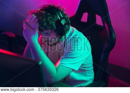 Cyber Sport. Fully Concentrated Professional Cybersport Gamer Playing Important Match. Caucasian Mal