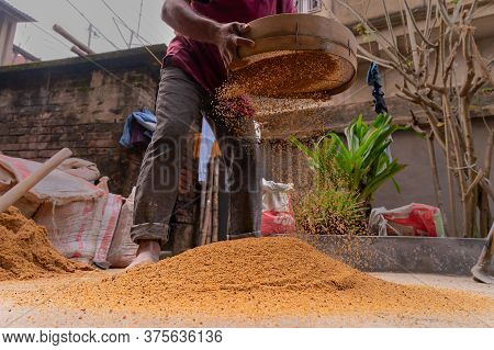Howrah, West Bengal, India - 6th January 2020 : Indian Labour Separating Sand And Gravel Manually Us