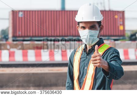 Portrait Of Businessman Or Engineer In Safety Helmet Congratulate A Winner Or Confident Gesture Givi