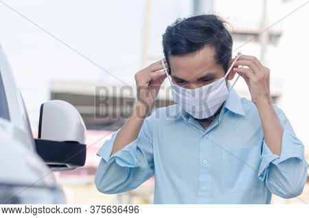 Masked Man From Covid-19 And Protection Against Pm 2.5 Air Pollution