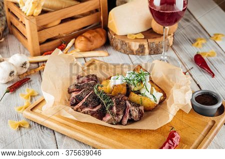 Sliced Lumbar Steak, Thin Sirloin With Baked Potatoes And Sour Cream, Horizontal