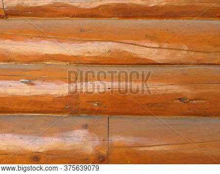 A Varnished Wood Cabin Wall Panel Background Backdrop
