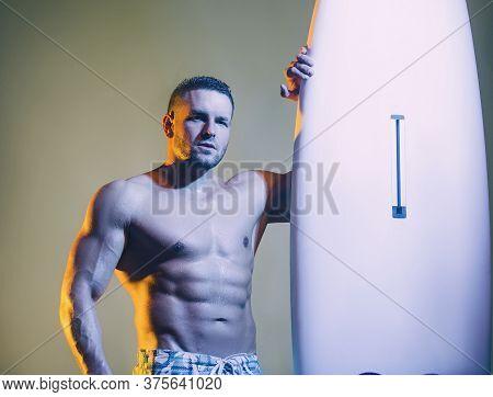 Handsome Muscular Man Holding Surfboard. Big Board For Heavy Men.