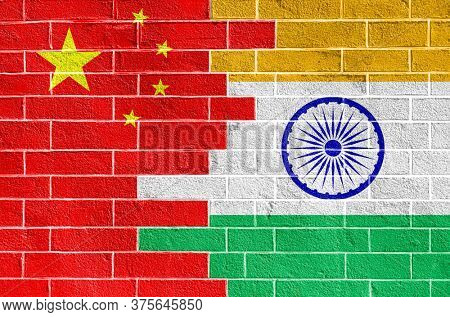 Flags of China and India on a brick wall. Background on the topic of international conflict