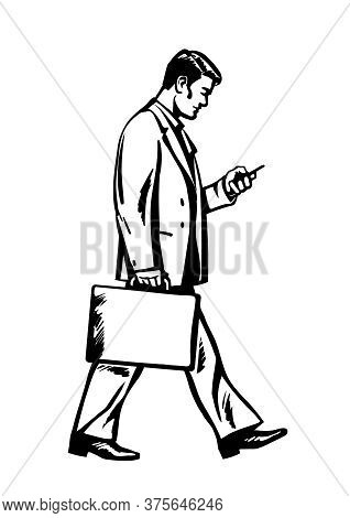 Young Businessman Walking With A Suitcase And Looking At Smartphone. Business Man Holding Mobile Pho