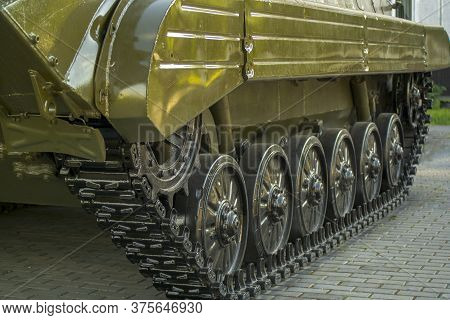 Tank Track, Standing By The Tracks On The Pavement