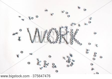 The Inscription Is The Word Work Lined With Bolts And Nuts. Bolts And Nuts On A White Background.rep