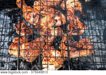 Appetizing Pickled Chicken Fried To Black On A Portable Picnic Grill