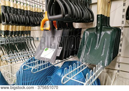 Moscow, Russia - August 17, 2019: Various Shovels Close-up On The Stand In A Building Materials Hype