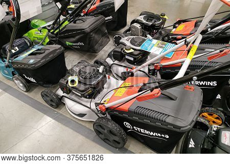 Moscow, Russia - August 17, 2019: Modern Petrol And Electric Lawn Mowers In A Building Materials Hyp