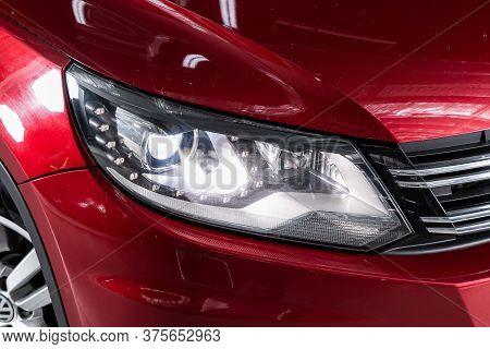 Novosibirsk/ Russia - April 28 2020: Volkswagen Tiguan, Red Car Headlights. Exterior Detail. Close U