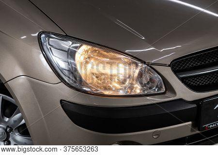 Novosibirsk/ Russia - July 04 2020: Hyundai Getz, Beige Car Headlights. Exterior Detail. Close Up De