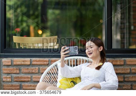 Leisure, Technology, Date, People And Holidays Concept. Portrait Of Attractive Sexy Lady Making Self