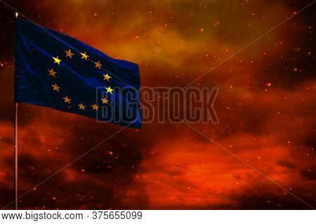 Fluttering European Union Flag Mockup With Blank Space For Your Data On Crimson Red Sky With Smoke P
