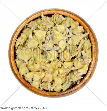 Greek Mountain Tea In Wooden Bowl. Also Known As Ironwort, Sideritis Or Shepherds Tea. Dried Floweri